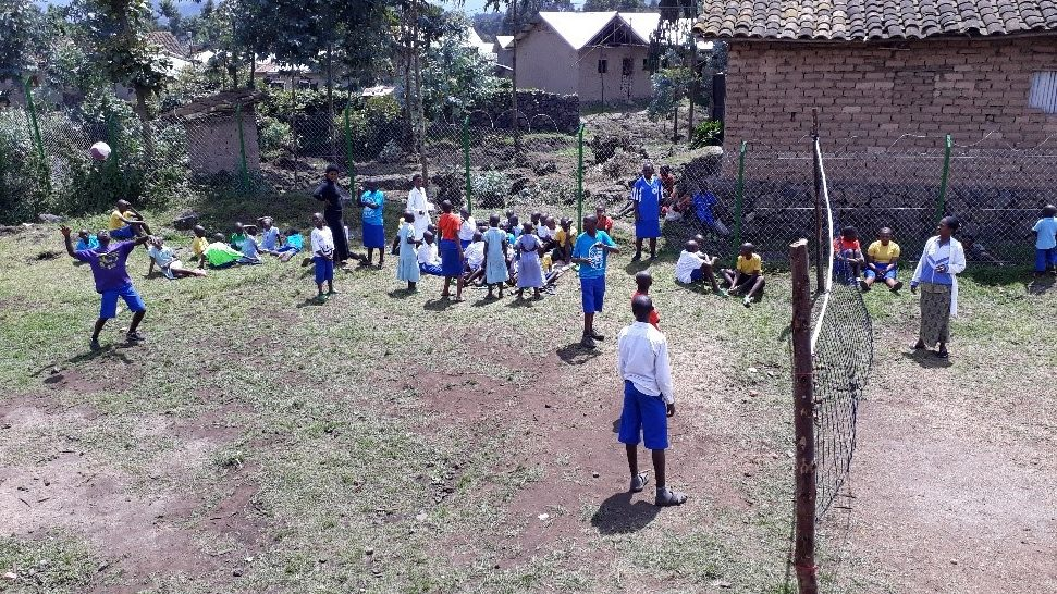 The volleyball court.  The children, and staff, love to play!  But the ground is not good, and when it rains, the pitch becomes impossible to use.