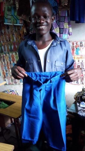 One of the tailoring students who is very proud of the school shorts that he has made.