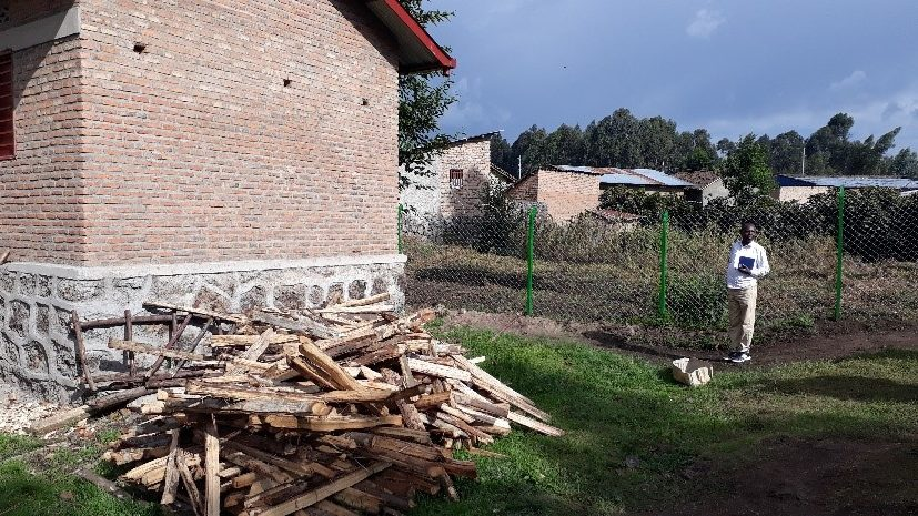 Here is the wood for the kitchen.  It would be good to have a gas cooker. The place where the wood has been temporarily deposited is where they would like to build a chicken house.